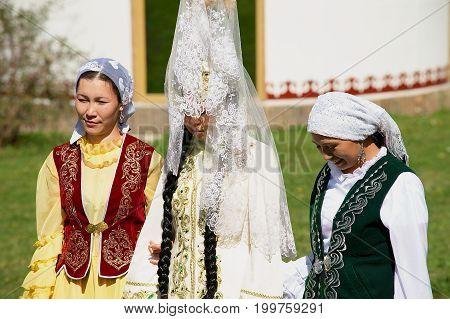 ALMATY, KAZAKHSTAN - SEPTEMBER 18, 2011: Unidentified lady (in the center) wears traditional Kazakh wedding dress in Almaty, Kazakhstan.