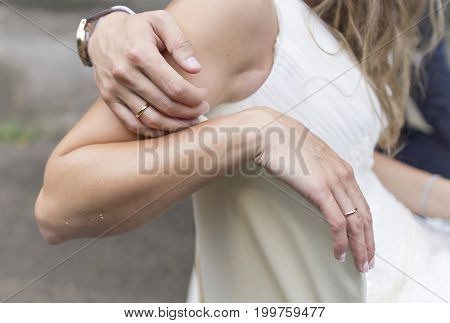 Love and tenderness gesture of a couple in their wedding day