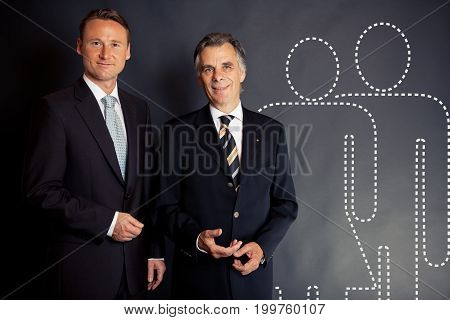 studio shot of a business team waiting offering you a job