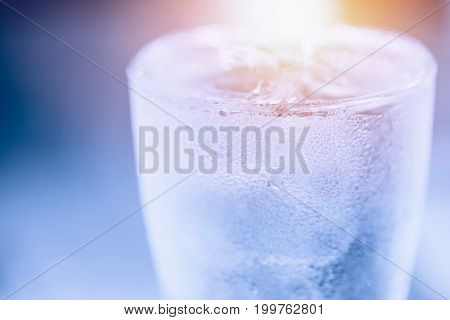 blue cool water condense to drop in summer hot summer day fresh chill drink concept.
