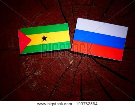Sao Tome And Principe Flag With Russian Flag On A Tree Stump Isolated