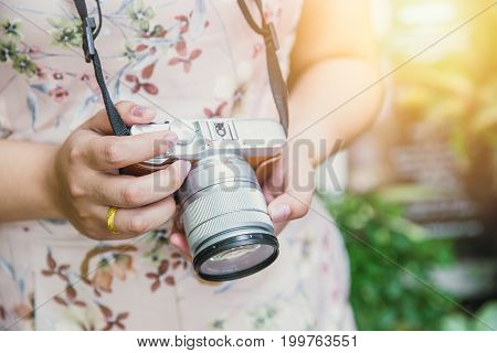 women hand hold mirror less digital camera vintage style tourist photography