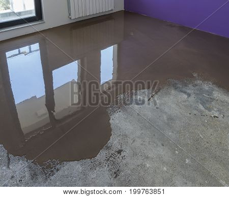 Floor covering with self leveling cement mortar. Mirror smooth surface of the floor