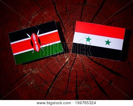 Kenyan Flag With Syrian Flag On A Tree Stump Isolated