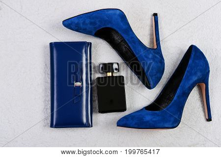 Shoes, Clutch And Perfume Bottle On Grey Background