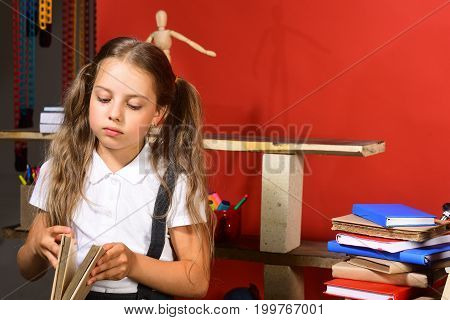 Education And Back To School Concept. Girl Opens Book