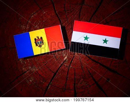 Moldovan Flag With Syrian Flag On A Tree Stump Isolated