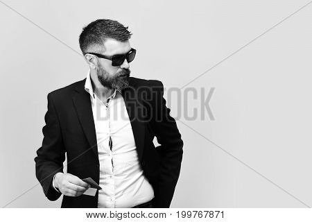 Businessman With Cards, Copy Space. Man In Suit With Beard