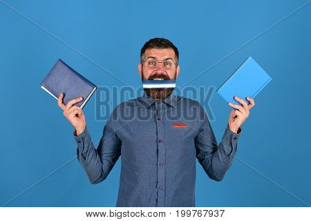 Knowledge And Studying Concept. Notebooks In Blue Color