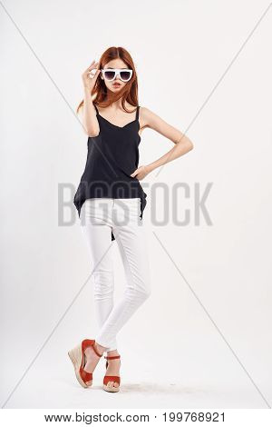 Woman on a white background with full-length glasses, fashion, beauty, style.