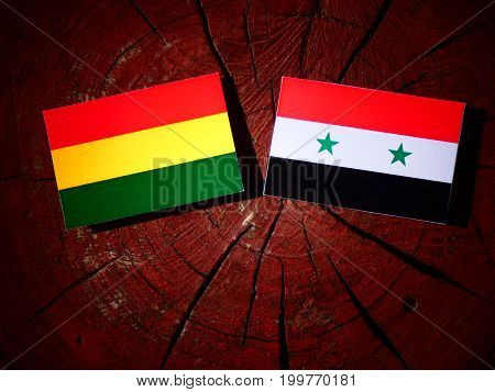 Bolivian Flag With Syrian Flag On A Tree Stump Isolated