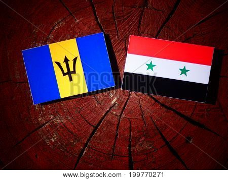 Barbados Flag With Syrian Flag On A Tree Stump Isolated