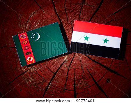 Turkmenistan Flag With Syrian Flag On A Tree Stump Isolated