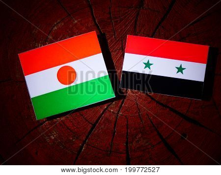 Niger Flag With Syrian Flag On A Tree Stump Isolated