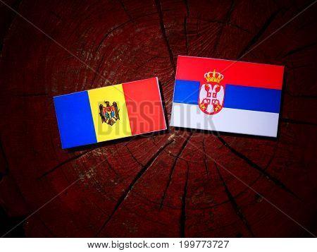 Moldovan Flag With Serbian Flag On A Tree Stump Isolated