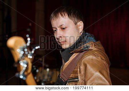 The bass guitarist plays the guitar at a concert