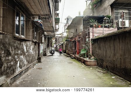 Poor street of Chengdu city by the business district. Sichuan province. China.