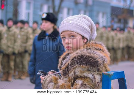 Zhytomyr, Ukraine - February 26, 2016: Girl on Military military parade, rows of soldiers at midday