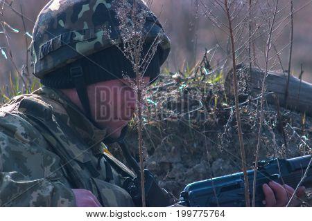 Zhytomyr, Ukraine - March 5, 2015: Front Line. Military attack on battlefield with guns from ambush