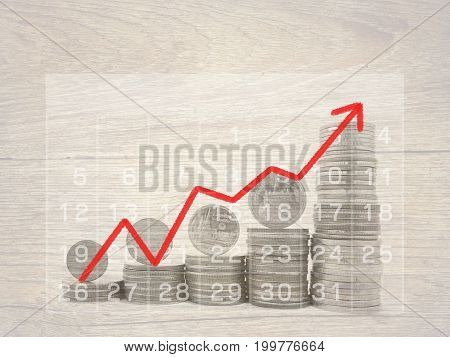 Coins stack with line graph for finance , business and banking concept.