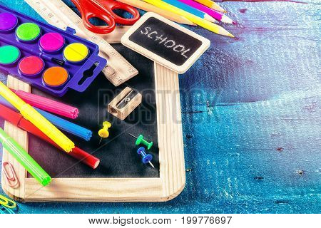 Colorful school supplies. Back to school concept with copyspace
