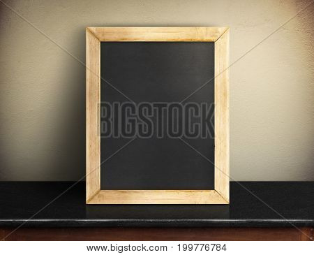 Blank Blackboard On Black Marble Table At Yellow Concrete Wall,template Mock Up For Adding Your Desi