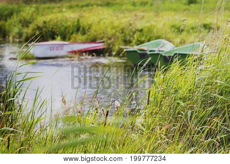 on the winding river stands several boats