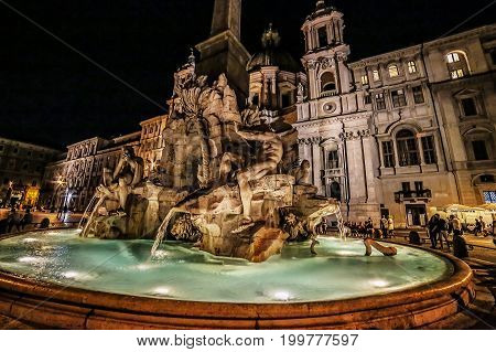 ROME ITALY - JUNE 2 2017: Piazza Navona Fountain of the Four Rivers and Egyptian obelisk. Night scene.