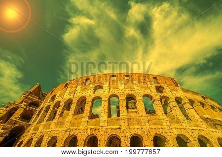 View outside the Colosseum Rome Italy with specific ruins and sky with clouds in background. Sunset light.