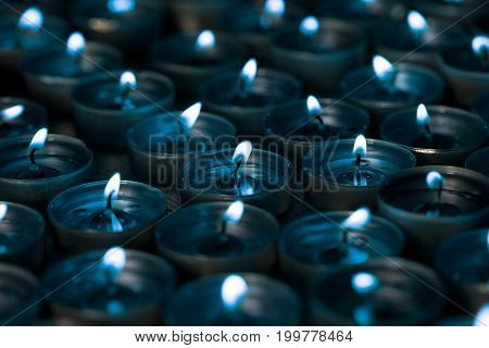 Nightlight. Lighted tea light candles at night with a silver blue tone. Cool mood lighting.