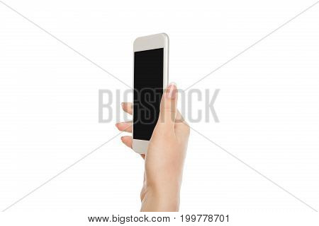 Woman hand holding mobile phone isolated on white background, close-up, cutout, copy space on the screen