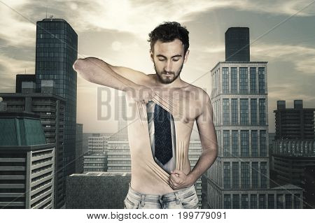 Shirtless man breks his skin and wearing a business suit underneath. Pulling his chest skin away showing bussiness suit urban background.