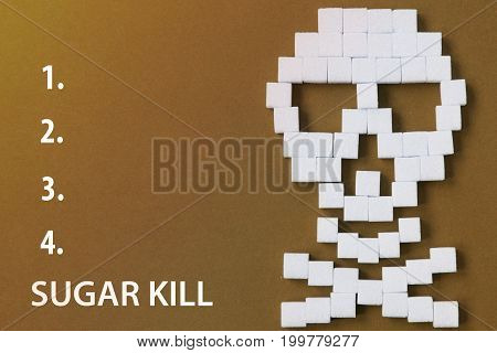 The skull made from sugar cubes. Sugar Kills. Blue background. diabetes concept. Suggesting dieting concept. Unhealthy white sugar concept. Copy space. Space for text.