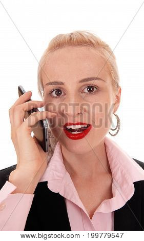 A closeup image of a young business woman talking on her cell phone with red lips and pink blouse isolated for white background