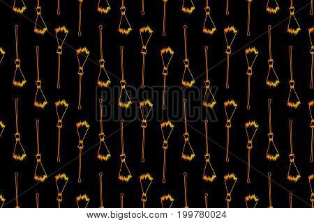 Golden broom on black background - vector pattern, Halloween witches broomstick - vector pattern, witches broom pattern