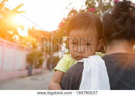 The girl hug her mother not in good mood.