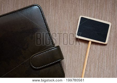 Brown memo book and small post are set in top view.