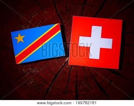 Democratic Republic Of The Congo Flag With Swiss Flag On A Tree Stump Isolated