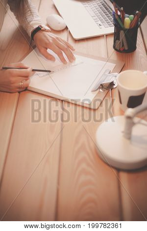 Young female working sitting at a desk. Businesswoman. Drawing. Student. Workplace. Desk.