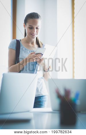 Woman use of mobile phone in university. Student woman
