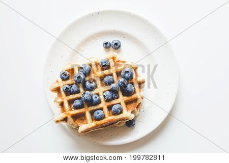 Top View Of Stacked Fresh Waffles With Blueberries