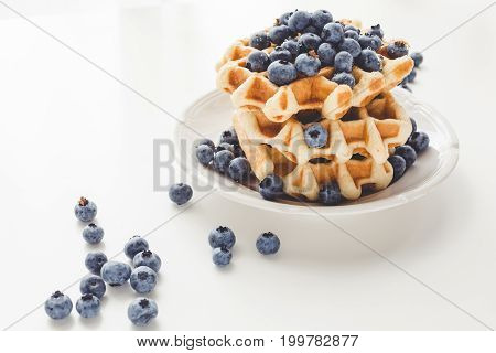 Plate Of Tasty Fresh Stacked Belgian Waffles With Blueberries