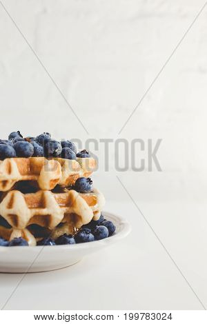 Plate Of Fresh Waffles Stack With Blueberries