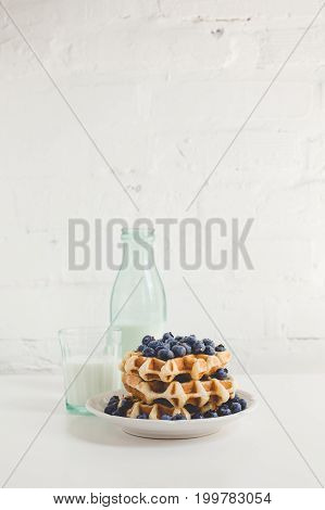 Delicious Breakfast Of Waffles With Blueberries And Glass Of Milk
