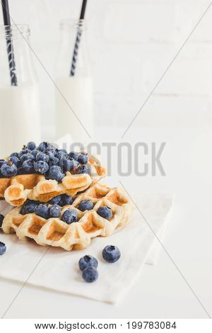 Delicious Breakfast Of Freshly Baked Waffles With Blueberries And Milk