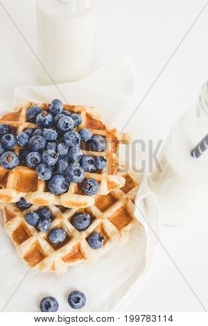 Delicious Breakfast Of Waffles With Blueberries And Two Bottles Of Milk