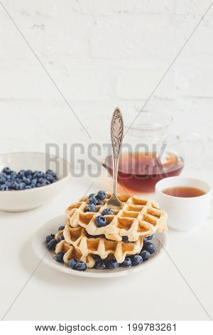 Healthy Breakfast Of Waffles With Blueberries And Tea