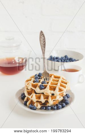 Delicious Breakfast Of Tasty Waffles With Blueberries And Tea