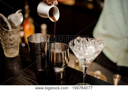 Bartender making Irish Coffee in a fancy restaurant