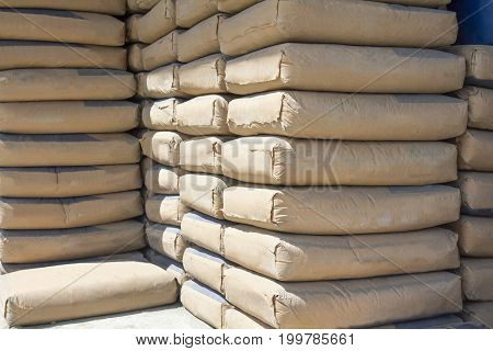 cement bags stacked in warehouse  for construction industry